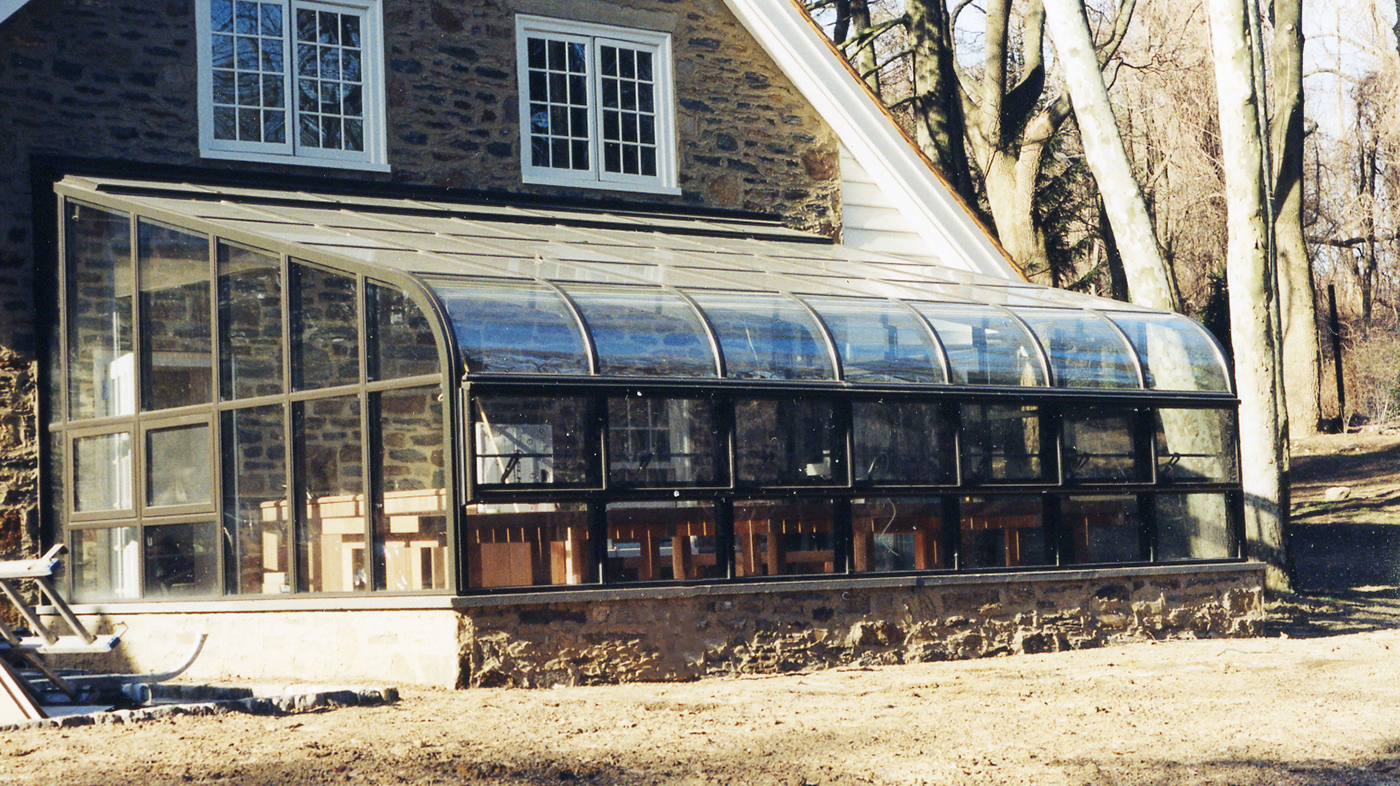 Curved eave lean to on this residential home.