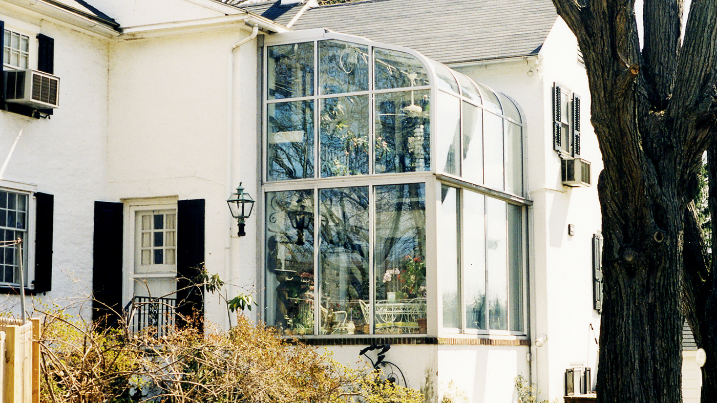 Curved eave lean to adding light to residential home as well as acting as in home greenhouse.