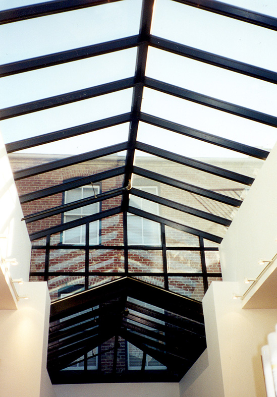 Straight eave double pitch multi-tier skylight with a hip end