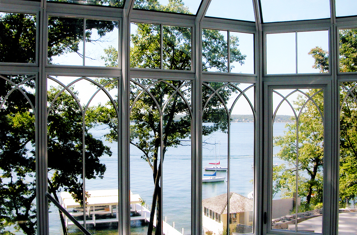 Bull nose end conservatory with gothic arch grids