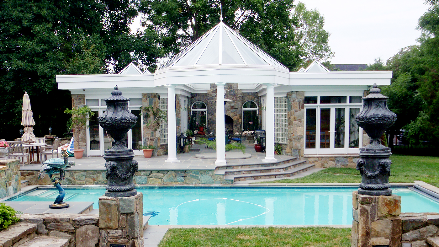 Pool house with a polygonal, double-pitch skylight and four pyramid skylights.