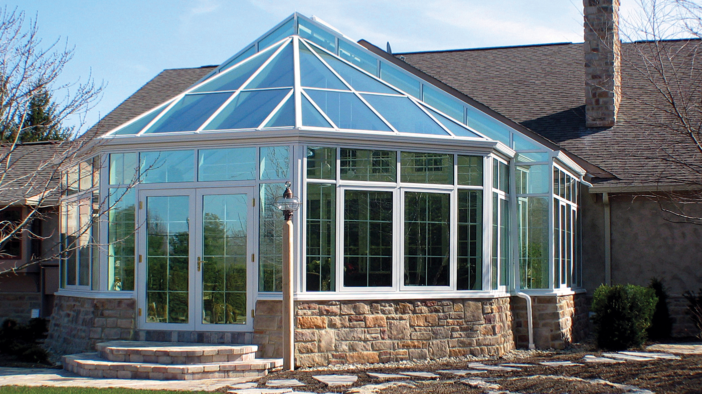 Straight eave double pitch conservatory with a bull nose end