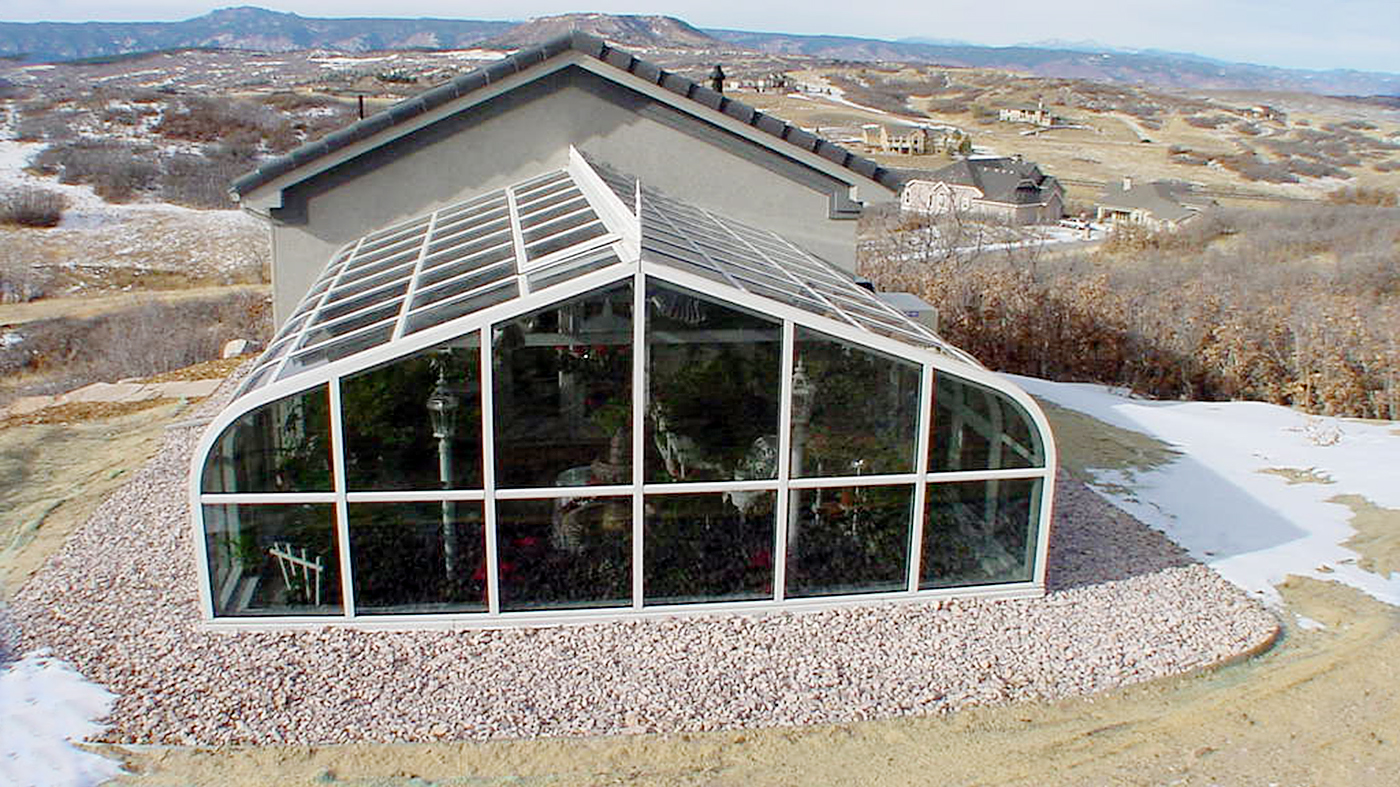 Curved eave double pitch greenhouse