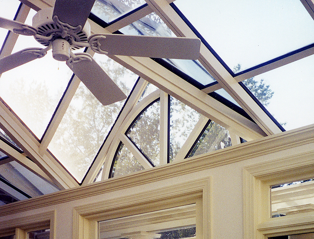 Straight eave lean-to skylight with a dormer and gable pediment