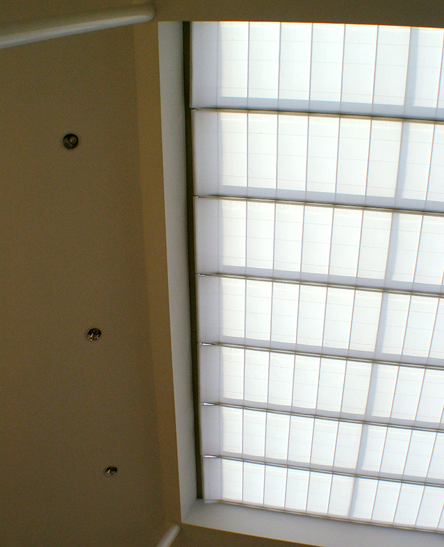 Single slope skylight with wide span shades