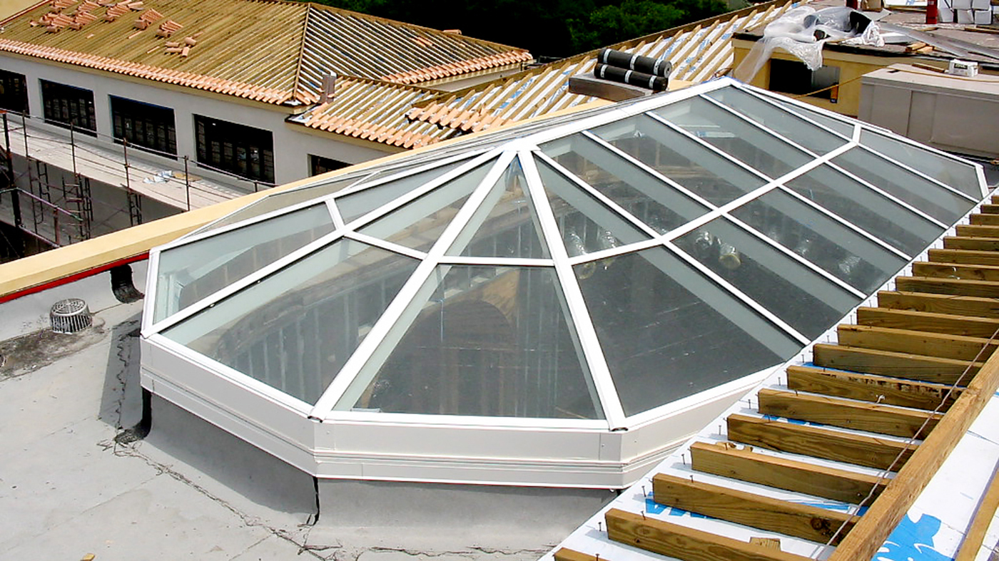 Three polygonal skylights - one 8-sided, one 10-sided, and one straight eave double pitch irregular bullnose end