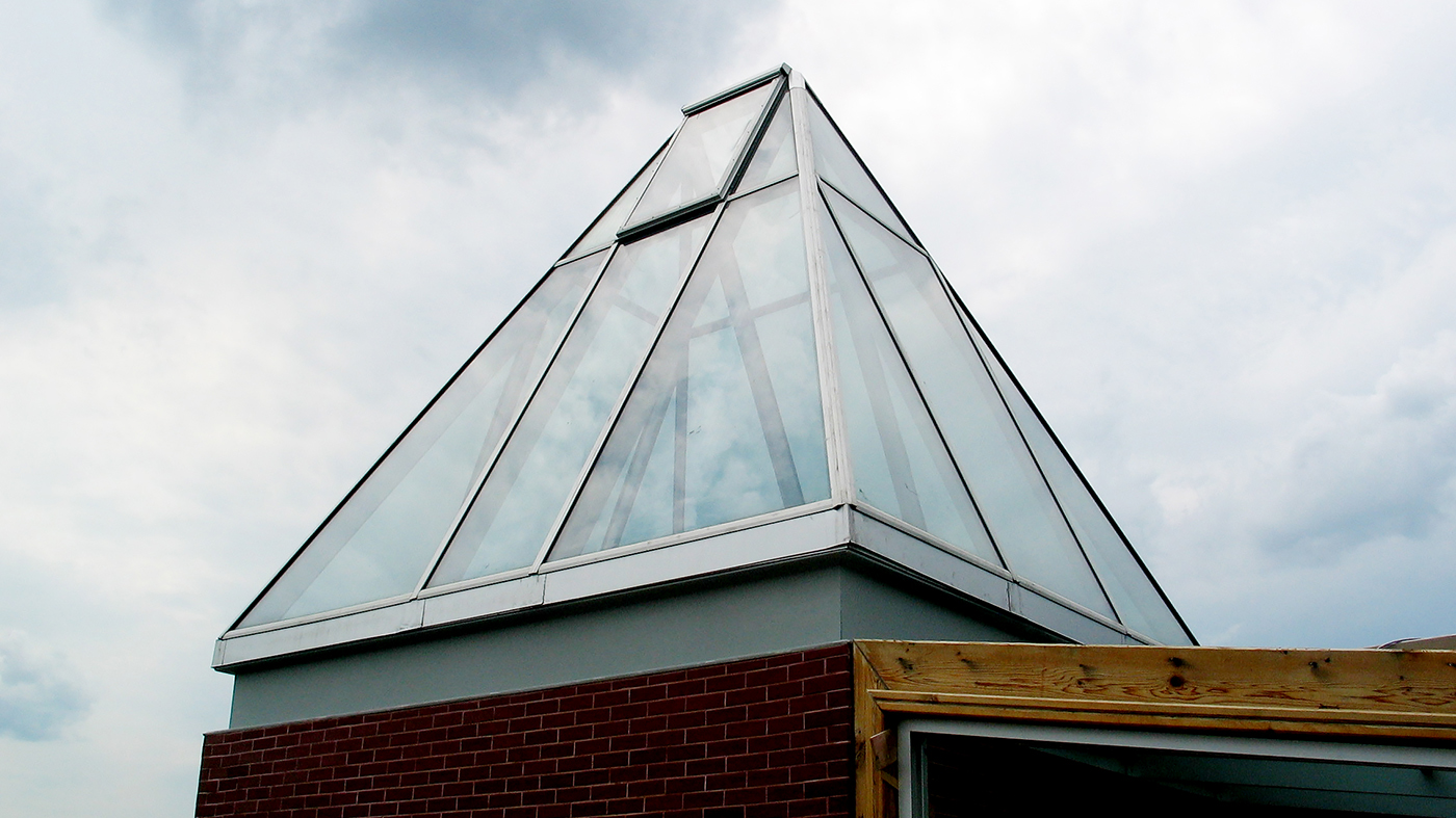 Straight eave double pitch skylight with one ridge vent