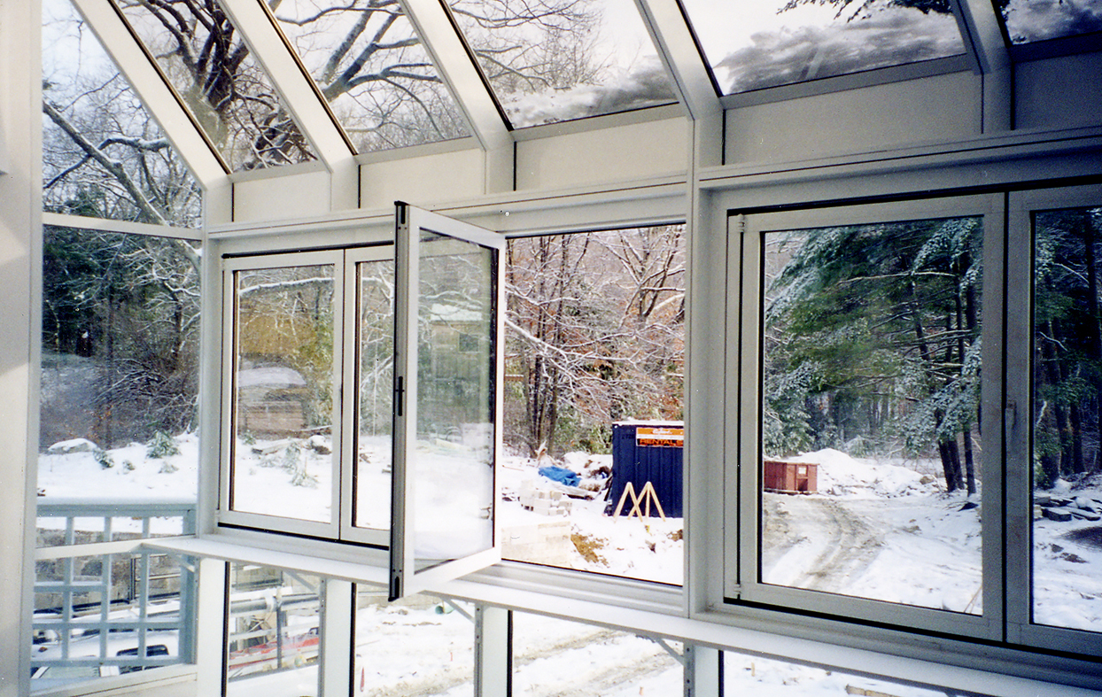 Complete glazing package, including single slope skylights, French doors, entryway roof access skylight with a terrace door, sliding glass doors, bifold windows, casement windows and a pool house.