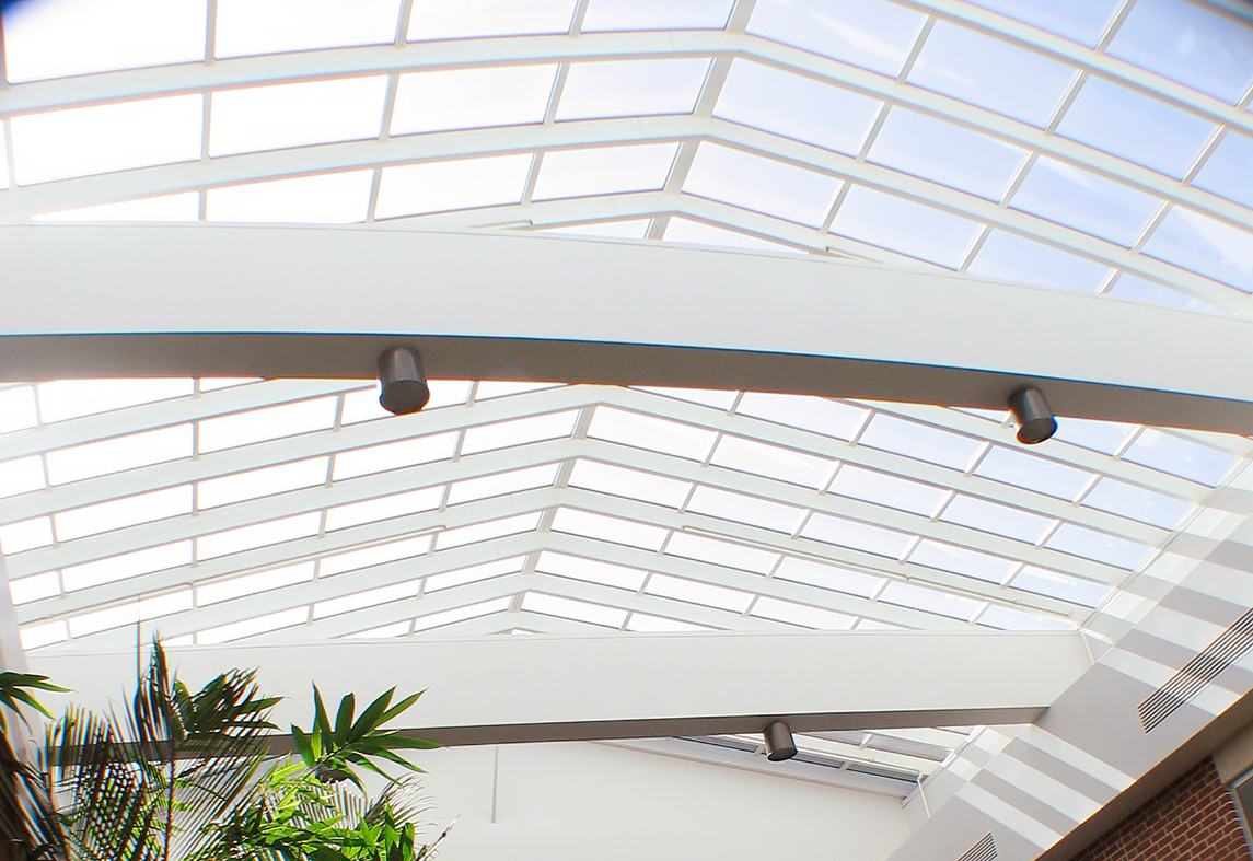 Straight eave double pitch skylight with one gable end