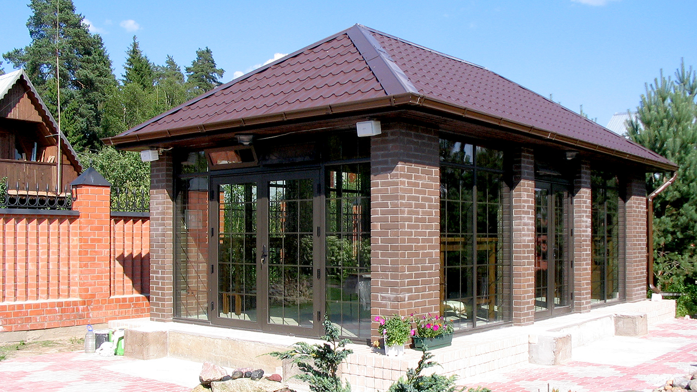 Aluminum curtain walls with integrated French doors and awning transom windows