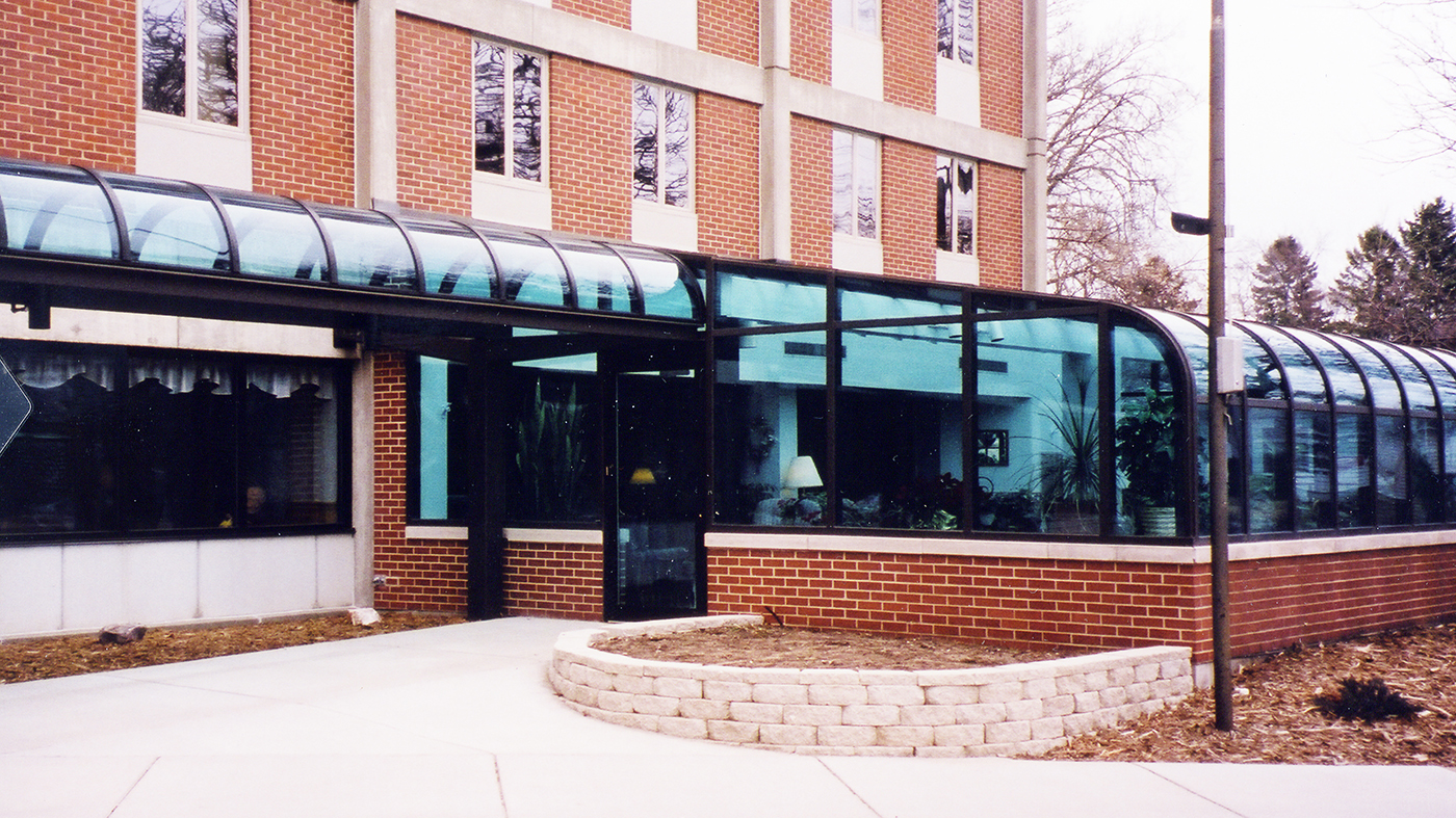 Curved eave canopy replacement glass