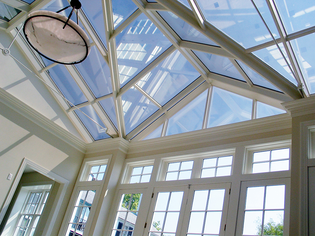 Straight eave double pitch skylight with a dormer