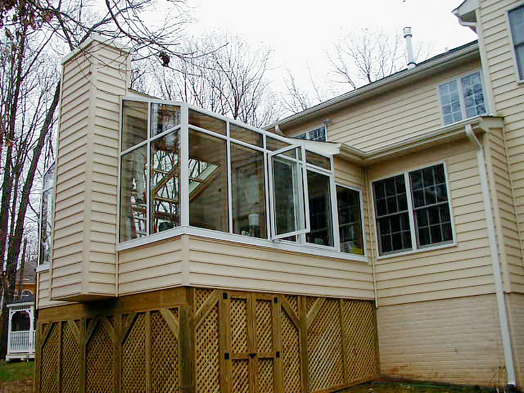 A pair of straight eave lean-to sunrooms with integrated windows and a door