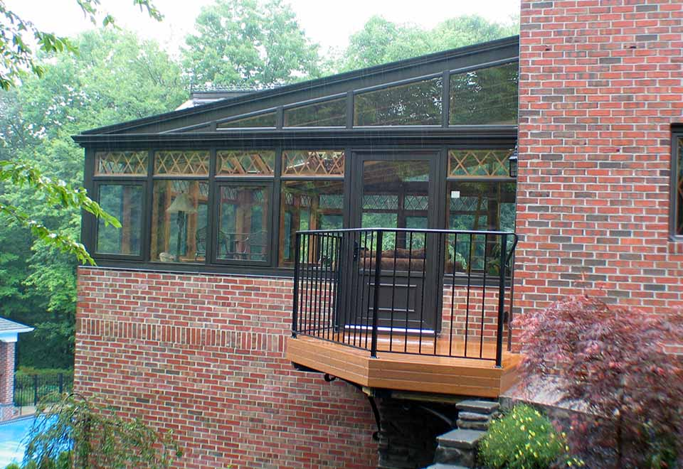 Straight eave, lean-to conservatory with double pitch dormer and aluminum exterior/Southern Yellow Pine Glulam interior