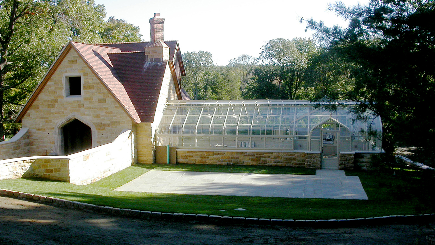 Curved eave double pitch greenhouse featuring ridge cresting, finials, and dormers