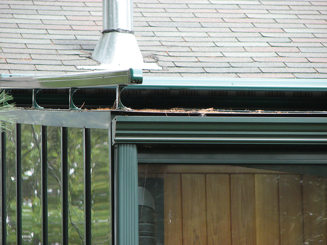 Straight eave lean to sunroom with two gable ends and exterior mounted sun shade system