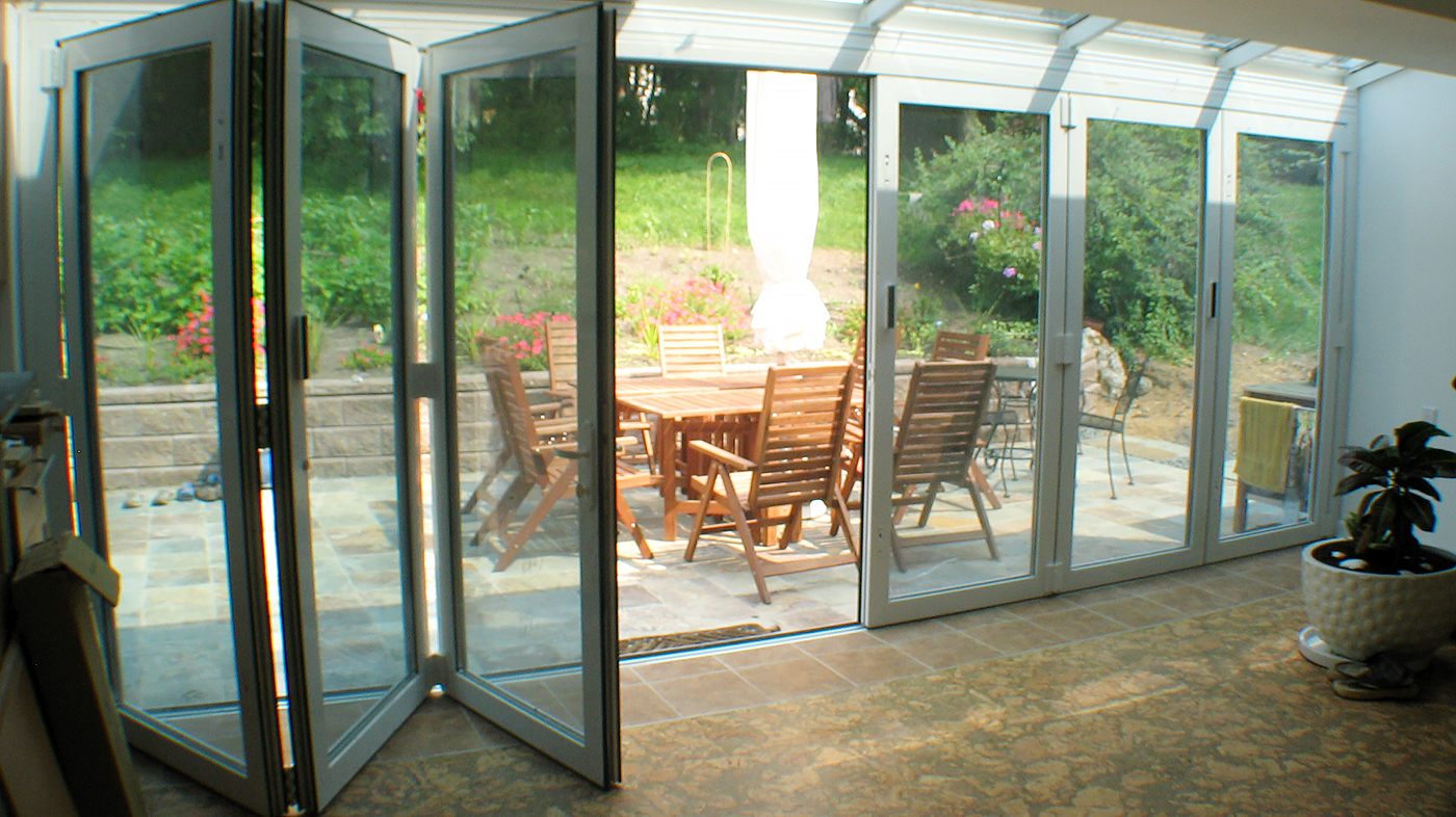 Folding glass wall with double door midwall configuration