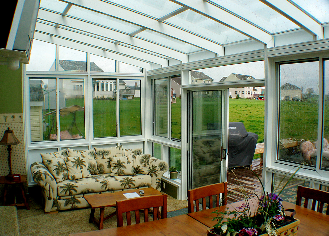 Straight eave lean to sunroom with sliding doors and windows