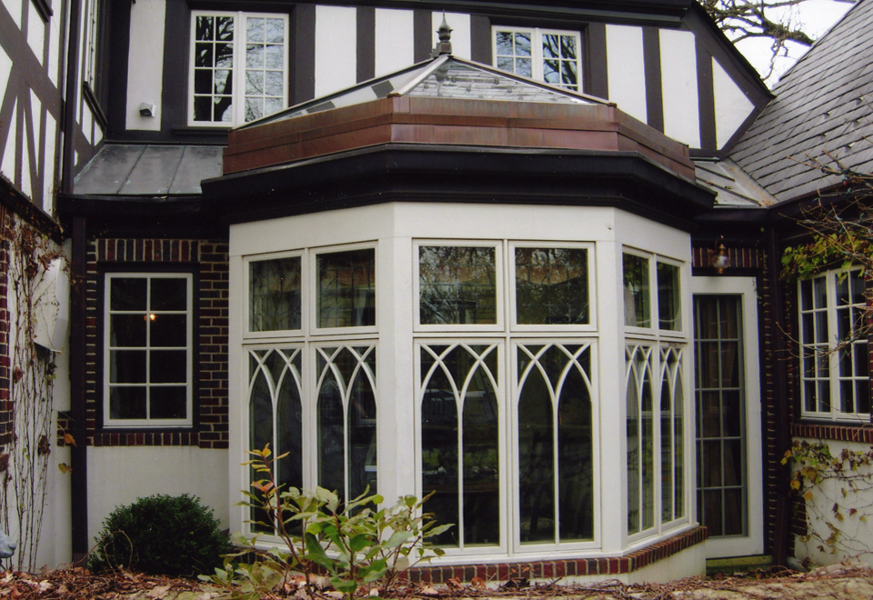 Straight eave double pitch skylight with one conservatory nose, copper clad exterior and mahogany wood interior