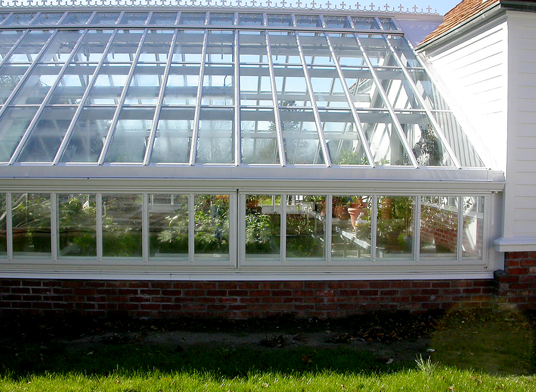 Straight eave, double pitch greenhouse with one glass partition. Attached double pitch greenhouse. Restoration System.