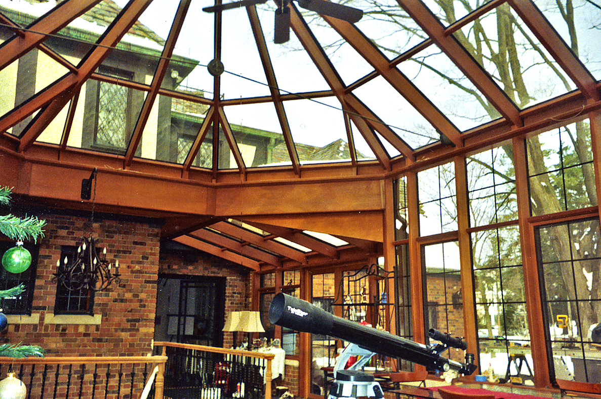 Conservatory with adjoined straight eave lean-to with one partial gable end. Mahogany interior.