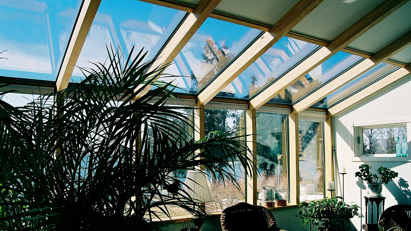 Straight eave lean-to skylight with Yellow Pine glulam interior and solid panel infills