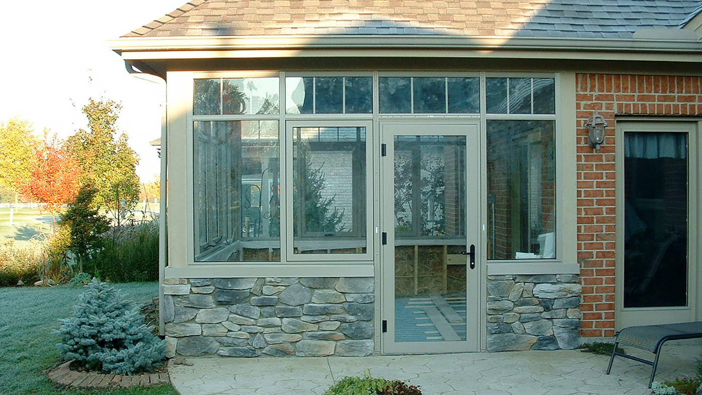 Three curtain wall sections, awning windows, a terrace door, and transoms