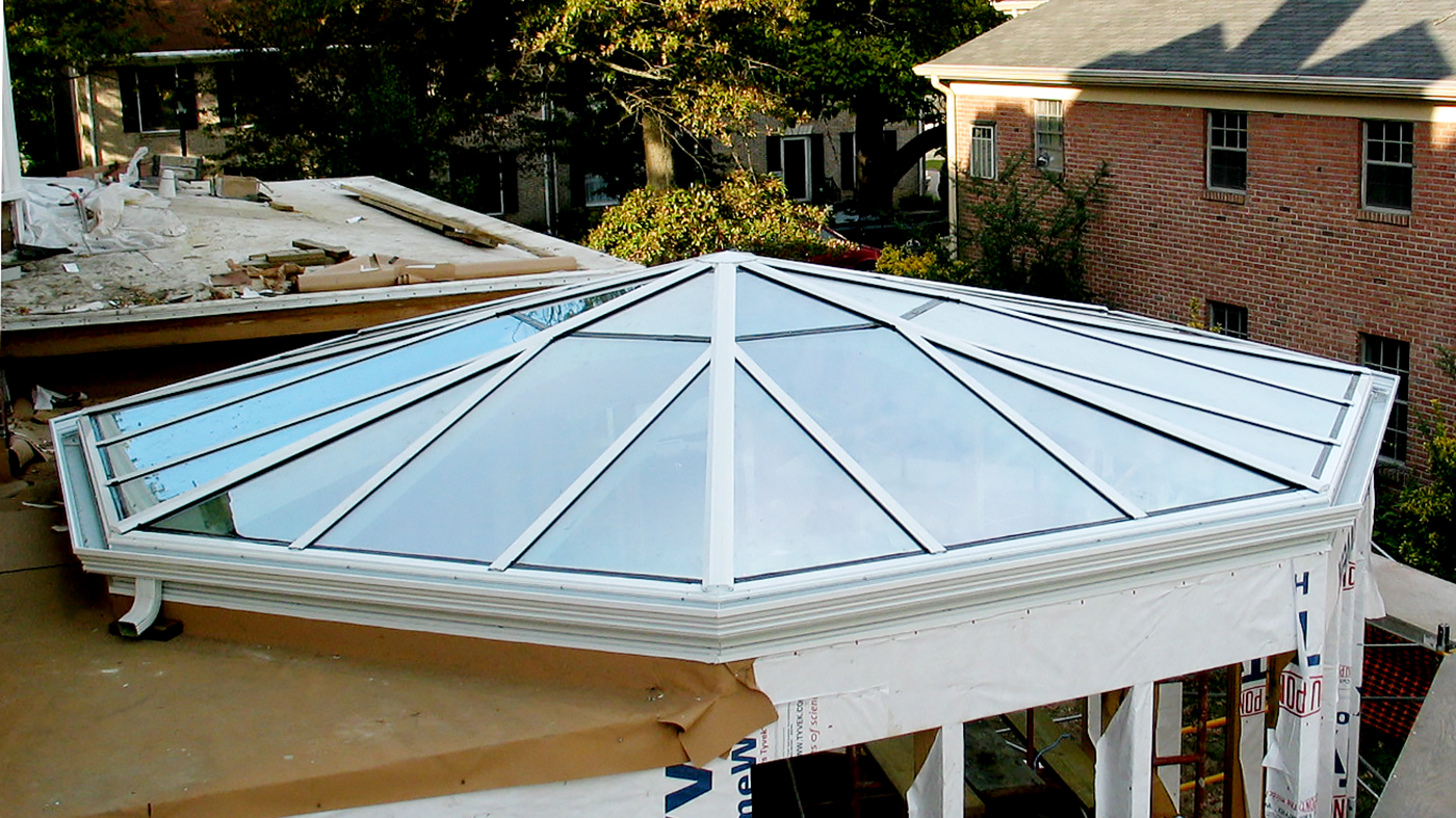 Polygonal skylight with structural glazed exterior