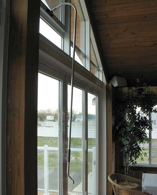 Aluminum curtain wall with integrated pole-operated awning windows and bifold doors.