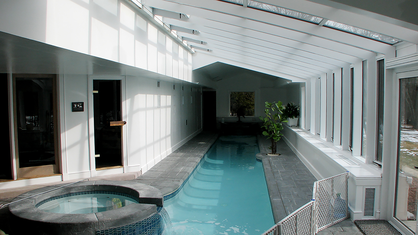 Straight eave, lean-to pool enclosure with awning windows and French doors