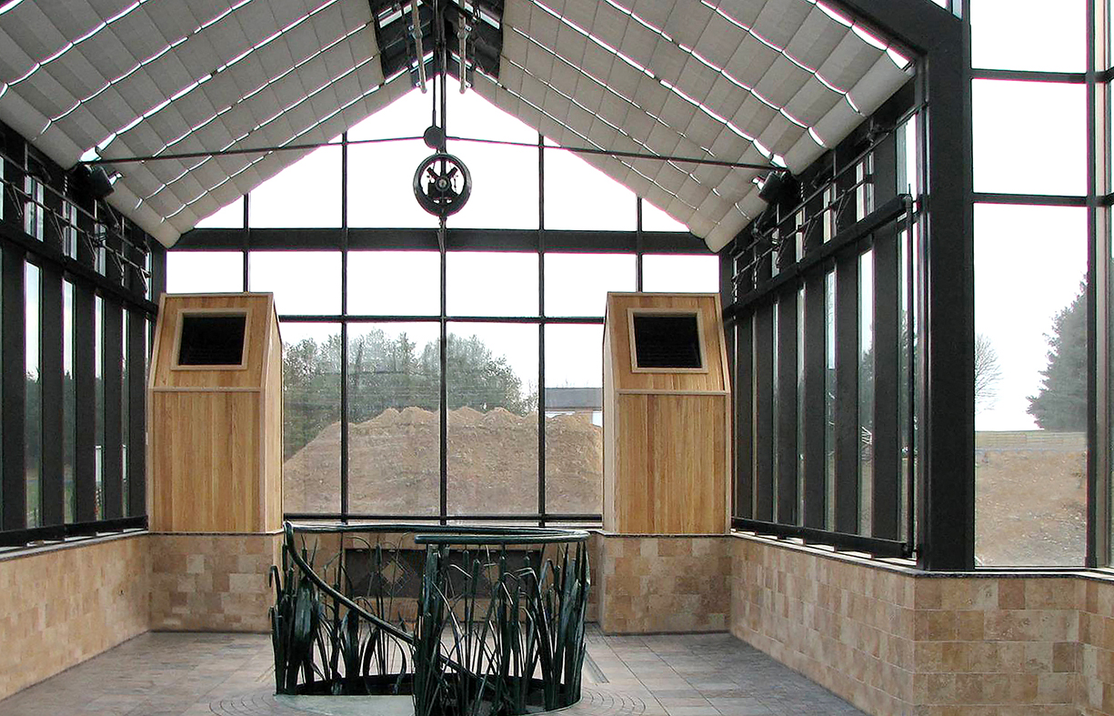 Straight eave double pitch structures attached to a central hip end greenhouse with a canopy entryway and a pyramidal cupola