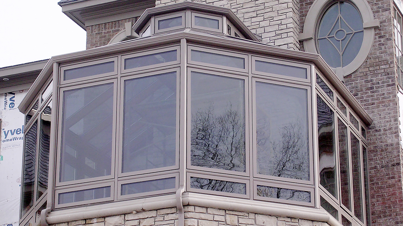 Straight eave, double pitch conservatory with Natural Clay aluminum exterior/Mahogany interior, lantern, ridge cresting, finial, and transoms.