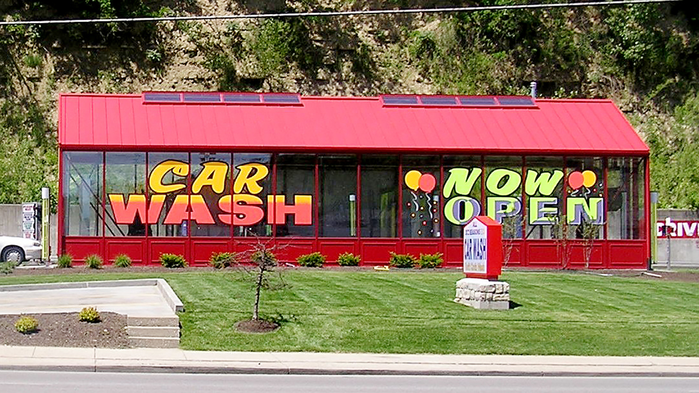 Straight eave double pitch car wash painted in red