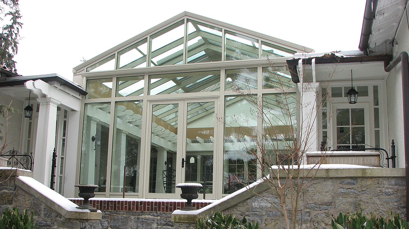 Straight eave double pitch sunroom and a lantern with two hip ends, ridge cresting, finials and ridge vents.