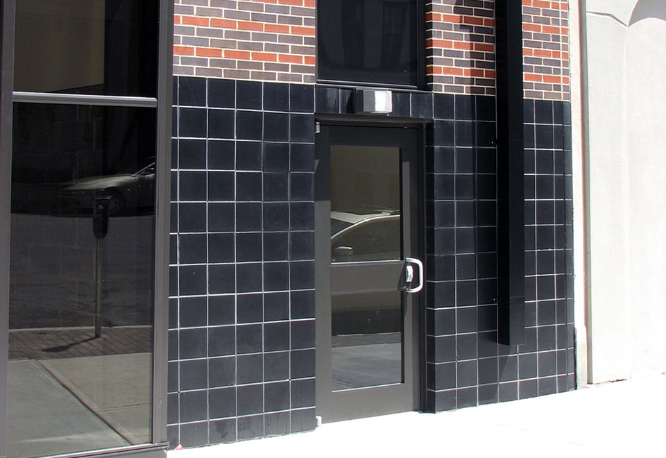 Custom curtain wall with canopy and lean-to with slanted gable ends.