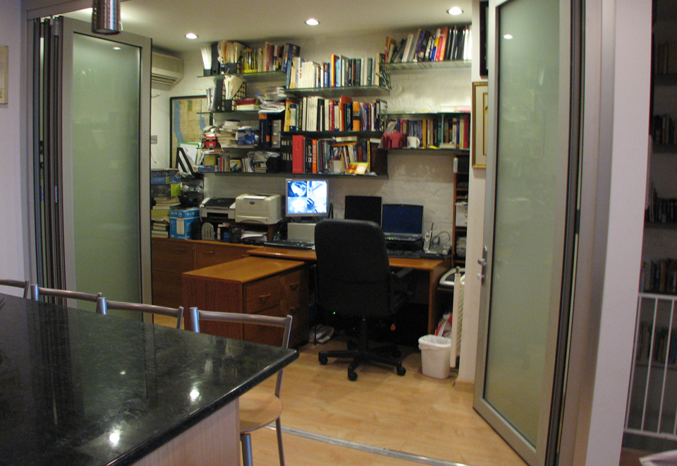 Folding wall system, single door hinge jamb configuration with one operable panel. The wall is interior, used with an office, and features specialty acid etch