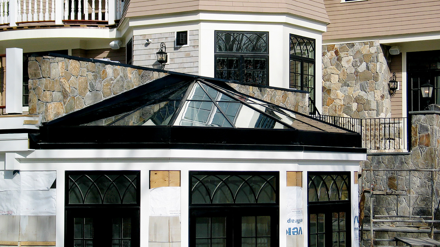 Straight eave double pitch bullnose end skylight