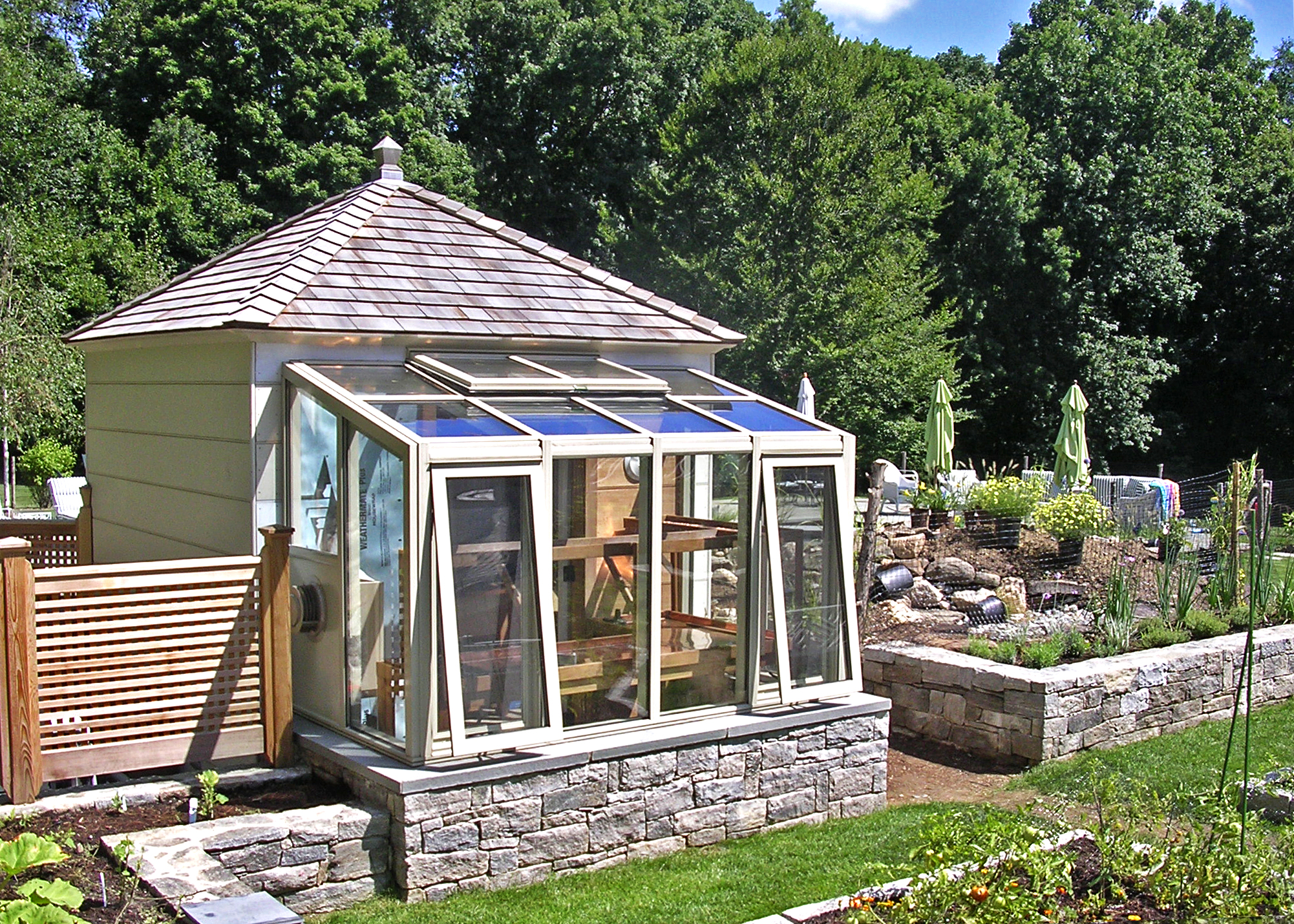 Straight eave lean-to greenhouse with 2 gable ends.