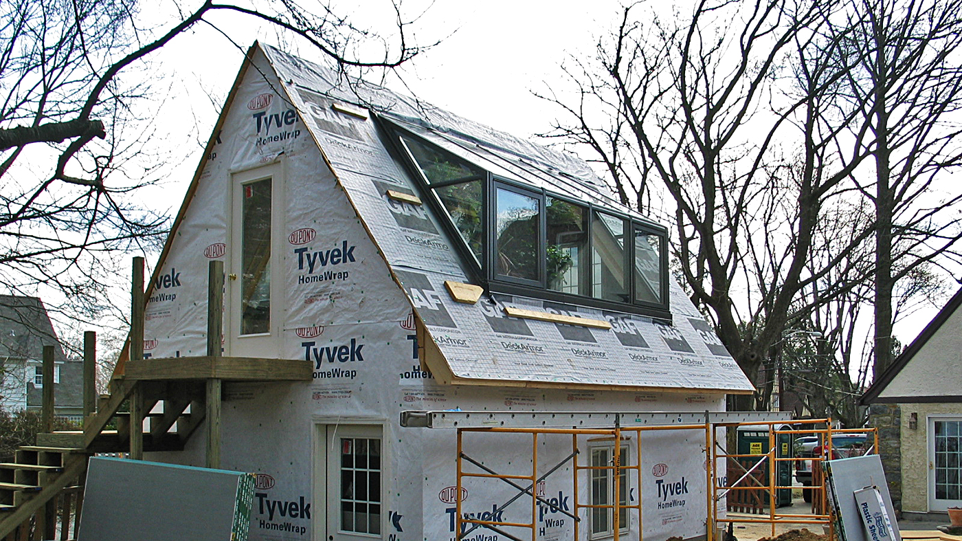 Straight eave lean-to greenhouse with 2 partial gable ends.