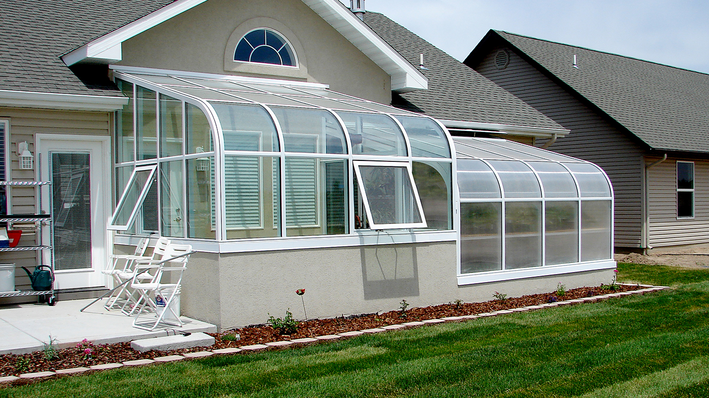 Two curved eave lean to sunrooms