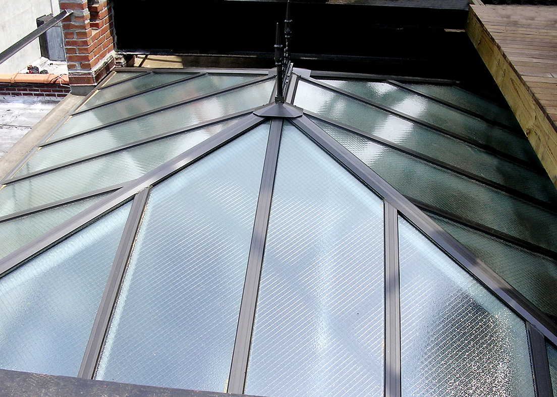 Three straight eave double pitch hip end skylights with wired glass