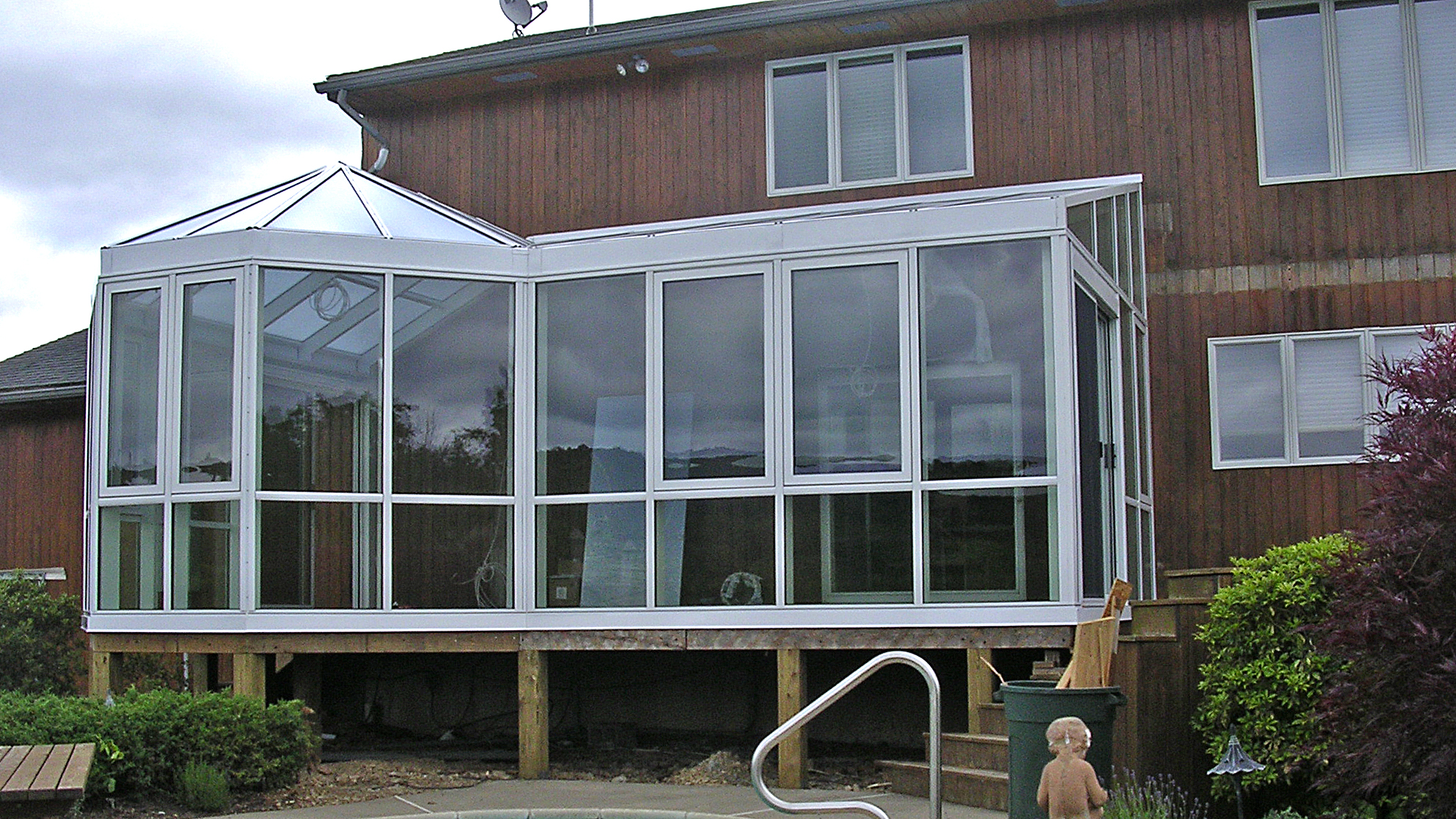 Straight eave lean-to with gable end attached to double pitch conservatory nose.