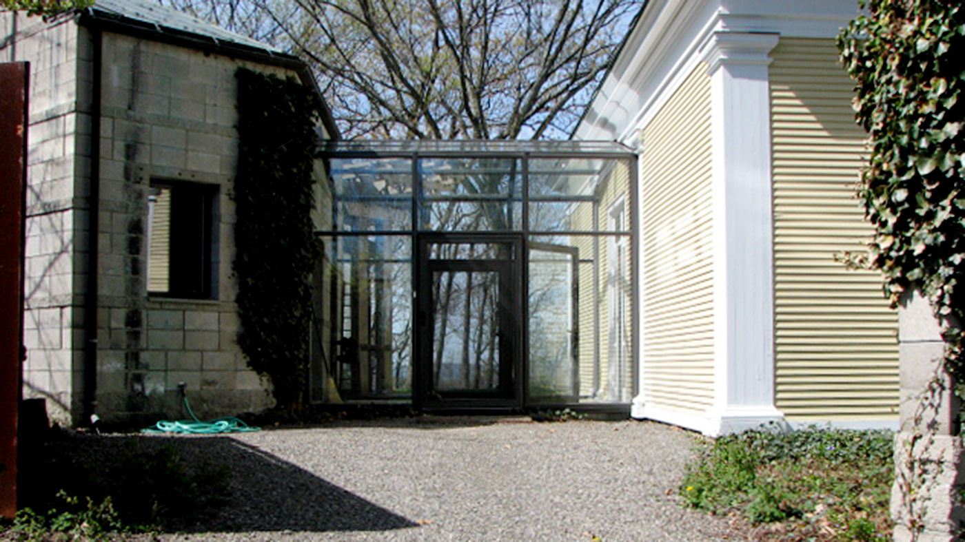 Straight eave lean-to sunroom with integrated terrace door and fixed windows
