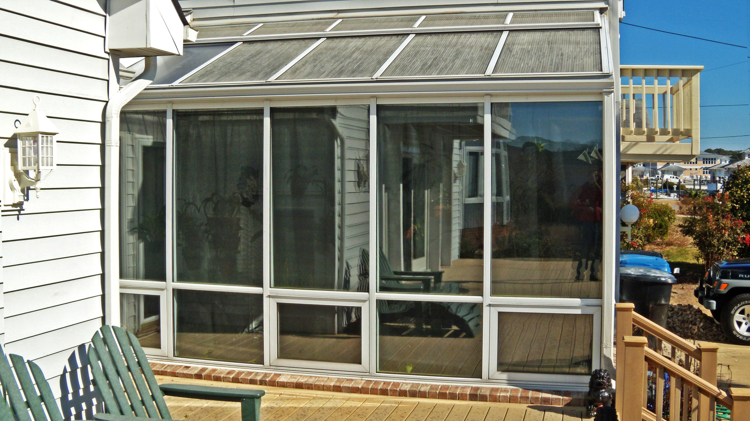 Straight eave lean-to sunroom.