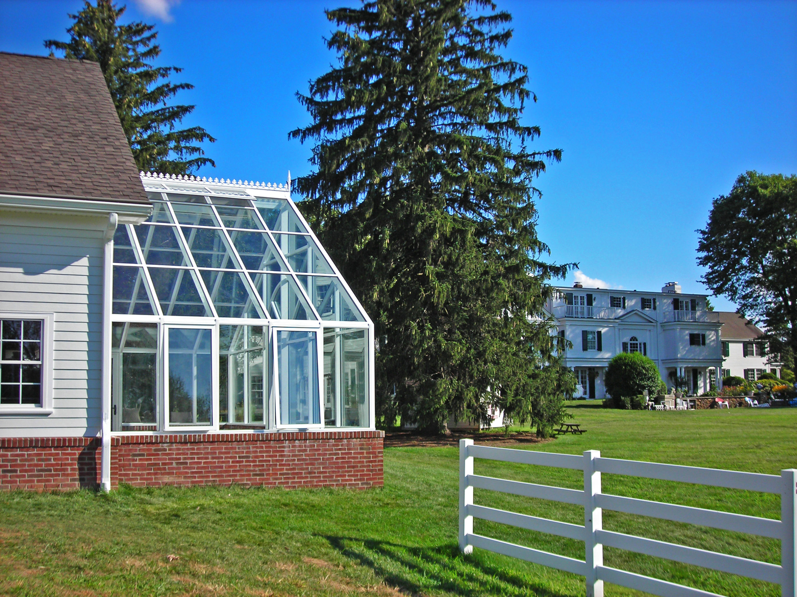Straight eave double pitch greenhouse.