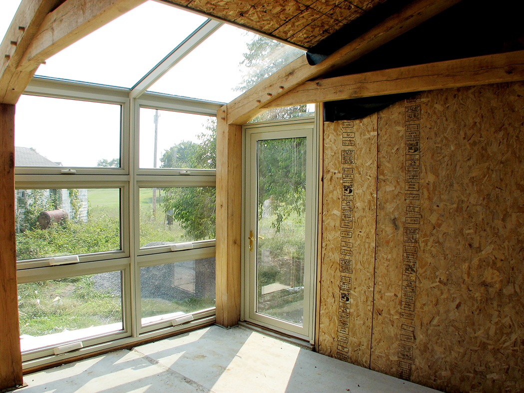 Straight eave lean-to sunroom and curtain wall with integrated awning windows