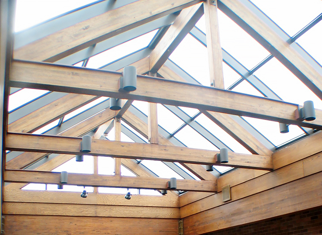 Straight eave, double pitch skylight.