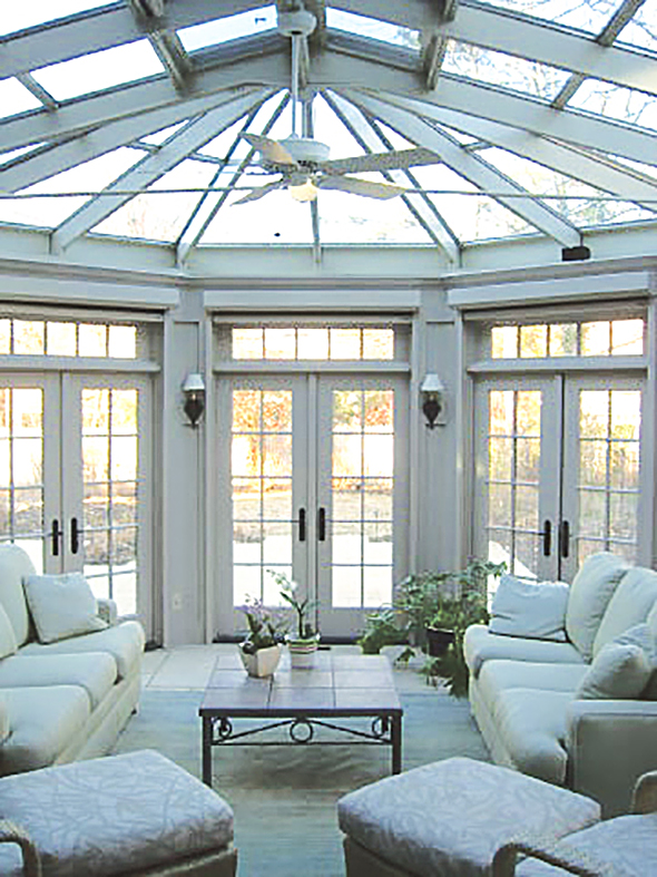 Straight eave lean-to conservatory skylight with bullnose projection and dormer area.