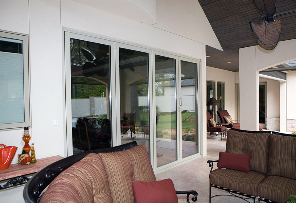 Folding wall system with an all wall system, top loaded, folds in with four panels that fold left and a recessed sill.