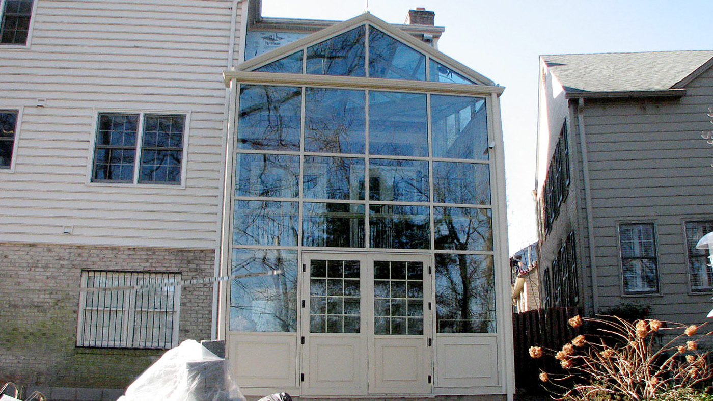 Straight eave lean-to two story conservatory